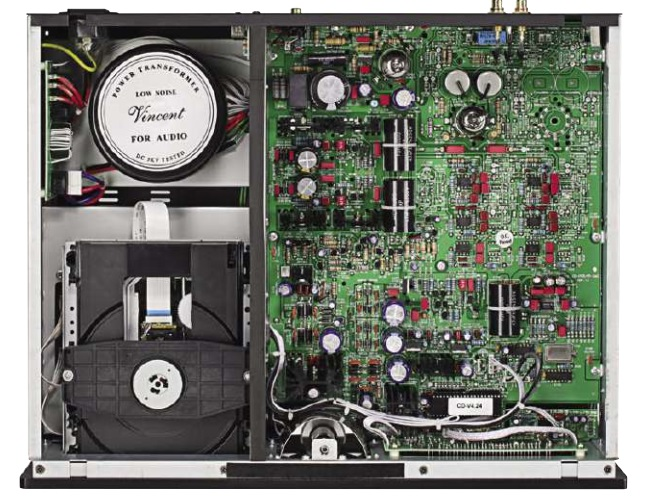 Inside the CD-S7 lies a large circuit board of unusual complexity, partly due to the need for valve power supply built around a 6Z4 valve rectifier. The 12AX7 (6922) valves can be seen at rear, whilst the Burr Brown PCM 1796 DAC chip is at right, surrounded by red capacitors.
